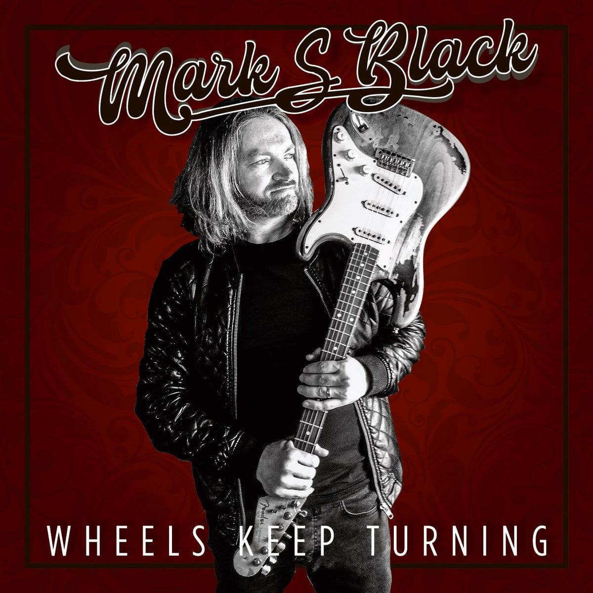 Mark Black Wheels keep turning
